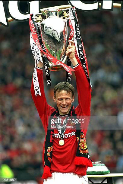 Teddy Sheringham lifts the Premiership Trophy after the FA Premiership match between Manchester United v Derby County at Old Trafford on May 5 2001...