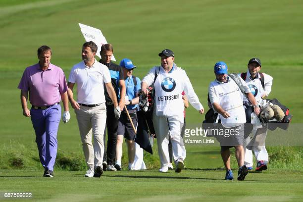 Teddy Sheringham Matt LeTissier and Tim Sherwood walk down the fairway with their caddies during the BMW PGA Championship ProAM at Wentworth on May...