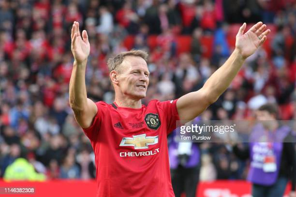 Teddy Sheringham of Manchester United '99 Legends acknowledges the fans at the end of the 20 Years Treble Reunion match between Manchester United '99...