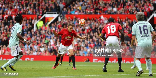 Teddy Sheringham of Manchester United '99 Legends heads the ball during the Manchester United '99 Legends and FC Bayern Legends match at Old Trafford...