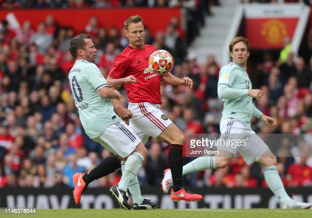 Teddy Sheringham of Manchester United '99 Legends in action with Lothar Matthaus of FC Bayern Legends during the 20 Years Treble Reunion match...