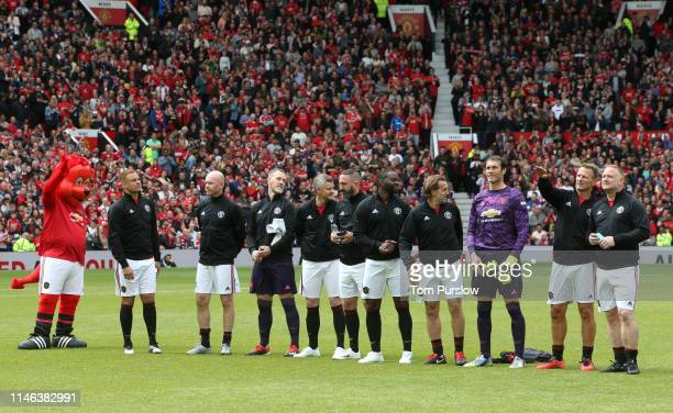 Teddy Sheringham of Manchester United '99 Legends looks on with his teammates prior to the 20 Years Treble Reunion match between Manchester United...