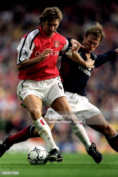 Teddy Sheringham of Manchester United battles for the ball with Arsenal's captain Tony Adams