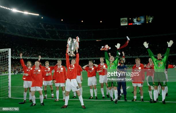 Teddy Sheringham of Manchester United lifts the European Cup surrounded by his team mates after victory in the UEFA Champions League Final between...