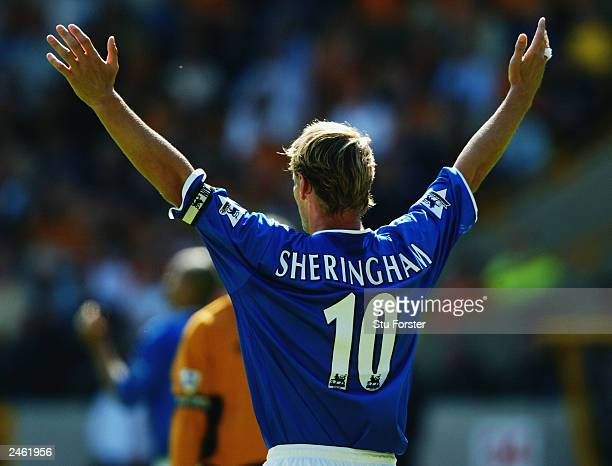 Teddy Sheringham of Portsmouth raises his arms during the FA Barclaycard Premiership match between Wolverhampton Wanderers and Portsmouth on August...