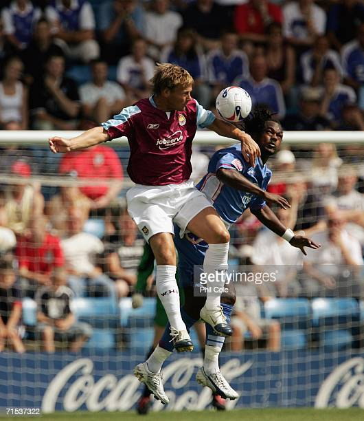 Teddy Sheringham of West Ham goes up for the ball against Danny Jackman of Gillingham during the Pre Season Friendly Match between Gillingham and...