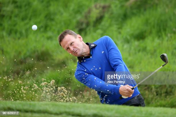 Teddy Sherringham plays out of a bunker during the Pro Am for the BMW PG Championship at Wentworth on May 23 2018 in Virginia Water England