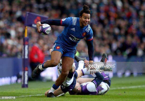 Teddy Thomas of France breaks through before scoring his sides first try during the NatWest Six Nations match between Scotland and France at...