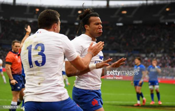 Teddy Thomas of France celebrates scoring his sides first try with Virimi Vakatawa during the 2020 Guinness Six Nations match between France and...