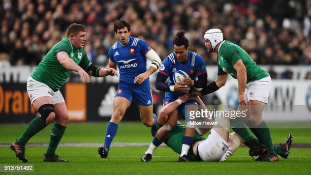 Teddy Thomas of France is tackled by Peter O'Mahony of Ireland during the Natwest Six Nations round One match between France and Ireland at Stade de...