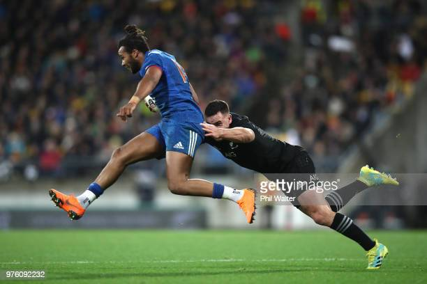 Teddy Thomas of France is tackled by Ryan Crotty of the All Blacks during the International Test match between the New Zealand All Blacks and France...