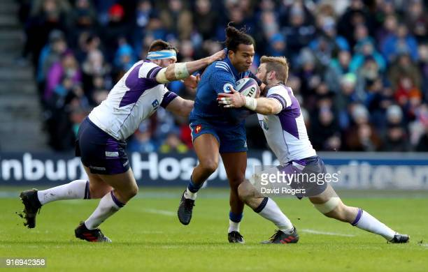 Teddy Thomas of France tackled by Simon Berghan of Scotland and John Barclay of Scotland during the NatWest Six Nations match between Scotland and...