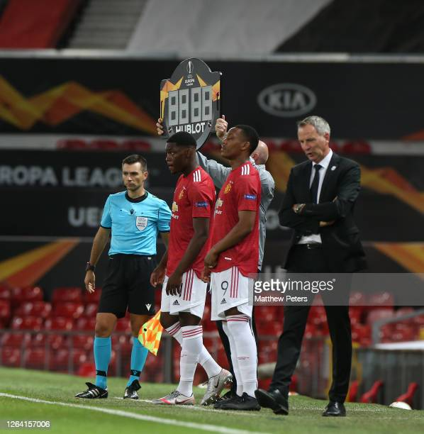 Teden Mengi and Anthony Martial of Manchester United come on as substitues during the UEFA Europa League round of 16 second leg match between...