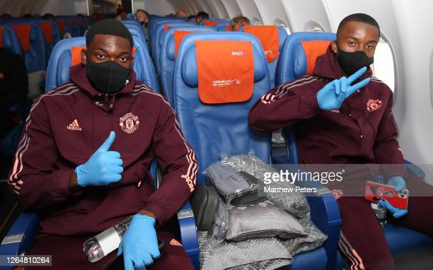 Teden Mengi and Ethan Laird of Manchester United poses on the plane ahead of their flight to Germany at Manchester Airport on August 09 2020 in...