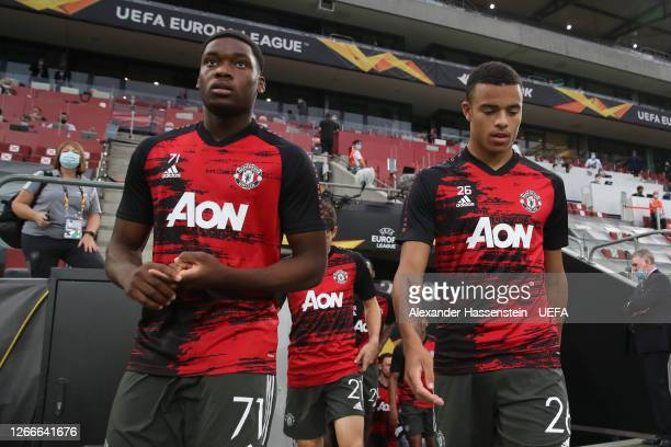 Teden Mengi and Mason Greenwood of Manchester United walk out to warm up prior to the UEFA Europa League Semi Final between Sevilla and Manchester...