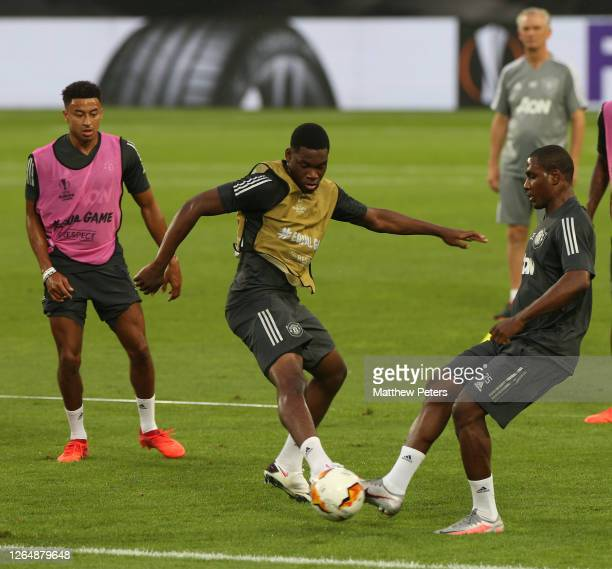 Teden Mengi and Odion Ighalo of Manchester United in action during a training session ahead of their UEFA Europa League Quarter Final match against...