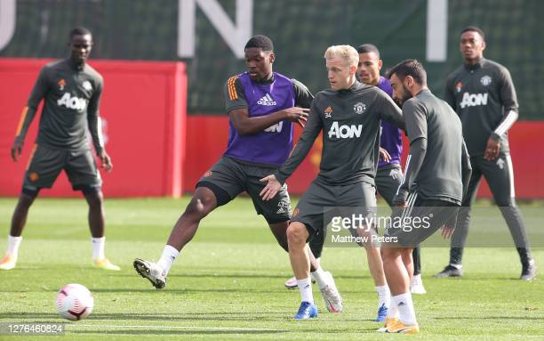 Teden Mengi Donny van de Beek Bruno Fernandes of Manchester United in action during a first team training session at Aon Training Complex on...