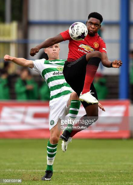 Teden Mengi of Manchester United and Scott Robertson of Celtic during the u19 NI Super Cup gala match at Coleraine Showgrounds on July 21 2018 in...