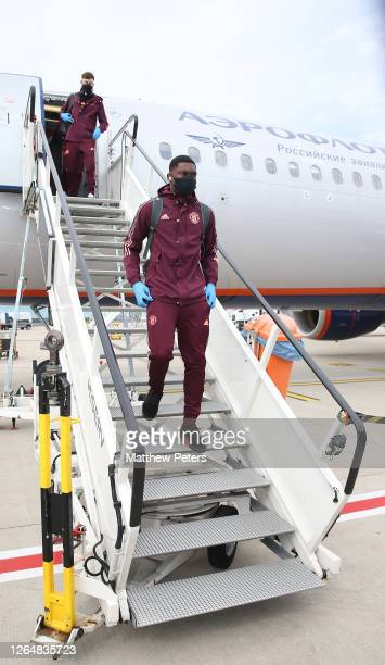 Teden Mengi of Manchester United arrives after their flight to Germany at Manchester Airport on August 09 2020 in Cologne Germany