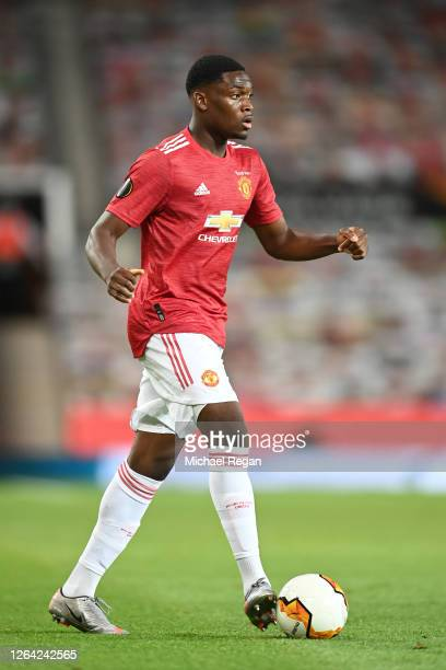 Teden Mengi of Manchester United in action during the UEFA Europa League round of 16 second leg match between Manchester United and LASK at Old...