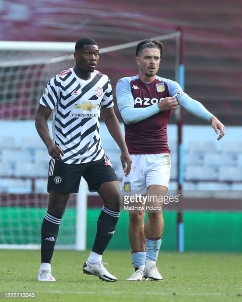 Teden Mengi of Manchester United in action with Jack Grealish of Aston Villa during a preseason friendly match between Aston Villa and Manchester...