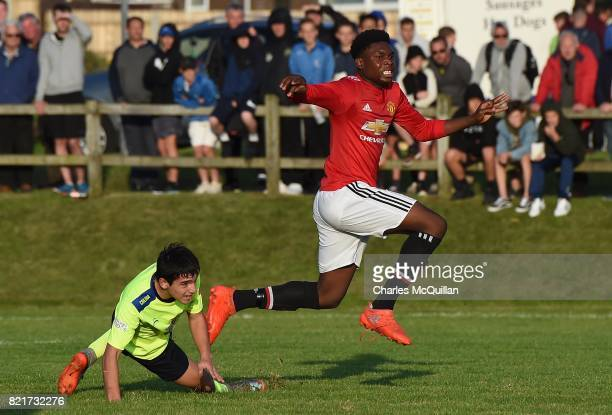 Teden Mengi of Manchester United turns to celebrate after scoring during the NI Super Cup junior section game between Manchester United and Colina at...