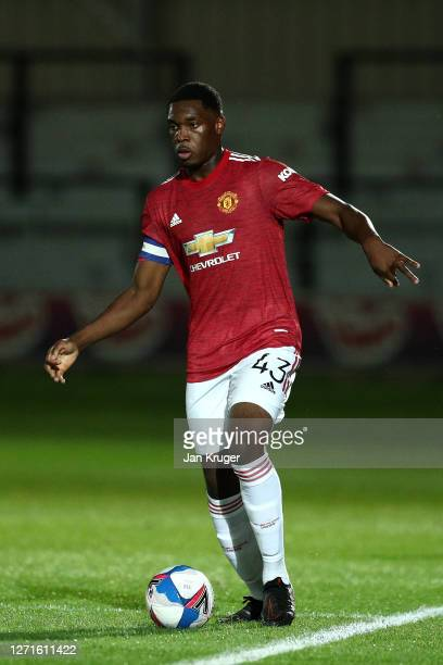 Teden Mengi of Manchester United U21 in action during the EFL Trophy match between Salford and Manchester United U21 at The Peninsula Stadium on...