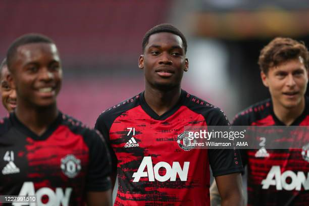 Teden Mengi of Manchester United warms up prior to the UEFA Europa League Quarter Final between Manchester United and FC Kobenhavn at...