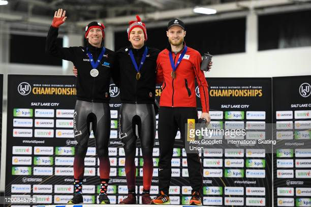 TedJan Bloemen of Canada Graeme Fish and Patrick Beckert of Germany stand on the podium after the men's 10000 meter during the ISU World Single...