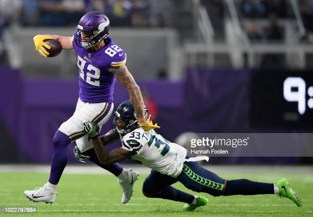 Tedric Thompson of the Seattle Seahawks tackles Kyle Rudolph of the Minnesota Vikings during the first quarter in the preseason game on August 24...