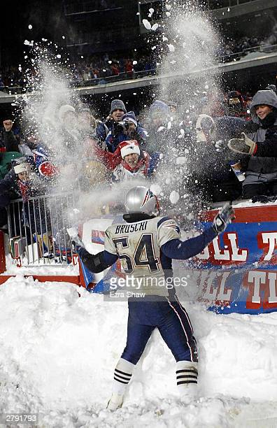 Tedy Bruschi of New England Patriots celebrates with the fans after they beat fans the Miami Dolphins on December 7 2003 at Gillette Stadium in...
