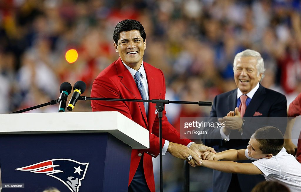Tedy Bruschi reacts during a ceremony in his honor at Gillette Stadium at the half time of a game between the New England Patriots and the New York Jets on September 12, 2013 in Foxboro, Massachusetts.