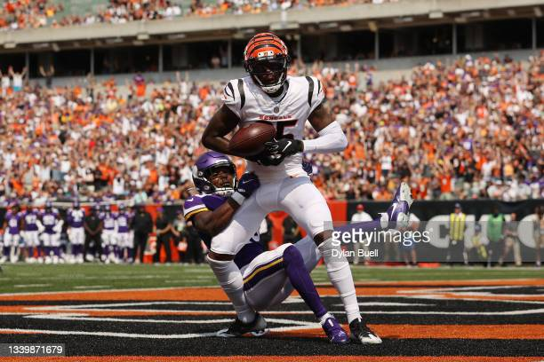 Tee Higgins of the Cincinnati Bengals catches a 2-yard touchdown pass from Joe Burrow during the second quarter against the Minnesota Vikings at Paul...