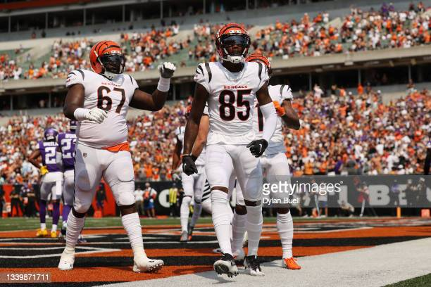 Tee Higgins of the Cincinnati Bengals celebrates after catching a 2-yard touchdown pass from Joe Burrow during the second quarter against the...