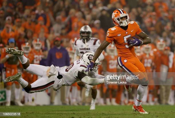 Tee Higgins of the Clemson Tigers gets away from R.J. Roderick of the South Carolina Gamecocks during their game at Clemson Memorial Stadium on...