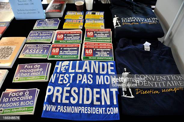 Tee shirts and stickers are in sell in a stand during a two-day convention of the French far-right organization Bloc Identitaire , on November 3,...
