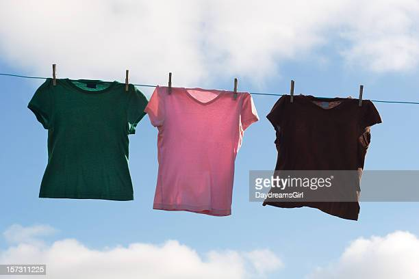 Tee Shirts Hanging on Clothesline Outdoors with Sky Background
