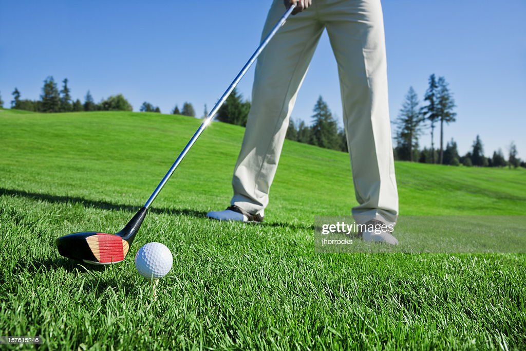 Teed and Ready to Swing : Stock Photo