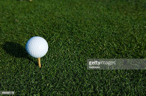teeing off a golf ball at a golf course - golf background stock photos and pictures