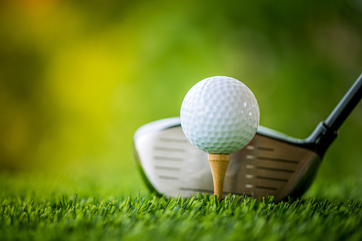teeing off with golf club and golf ball 813012122