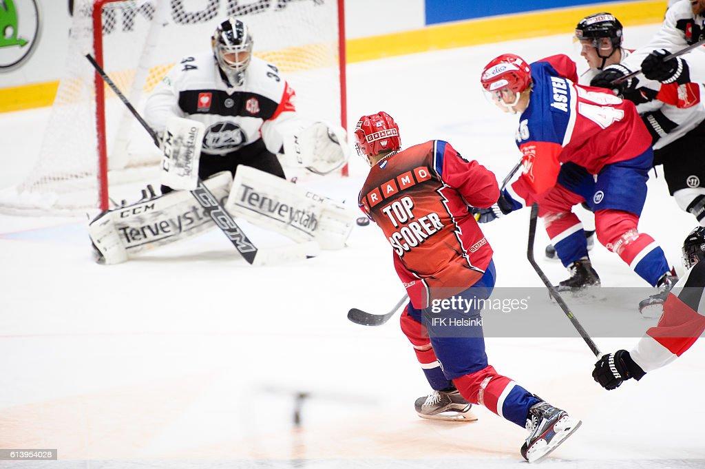 #42 Teemu Eronen of IFK Helsinki just misses the net during the Champions Hockey League Round of 32 match between IFK Helsinki and TPS Turku at Helsingin Jaahalli on October 11, 2016 in Helsinki, Finland.