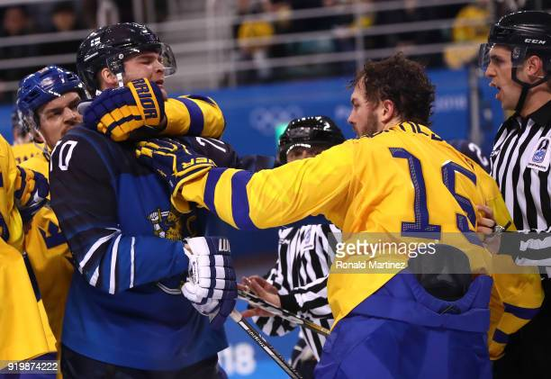 Teemu Hartikainen of Finland and Simon Bertilsson of Sweden exchange words in the third period during the Men's Ice Hockey Preliminary Round Group C...