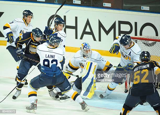 Teemu Laine defends with his team mates against Camilo Miettinen of Espoo Blues during the IIHF Champions Hockey League match between Espoo Blues and...