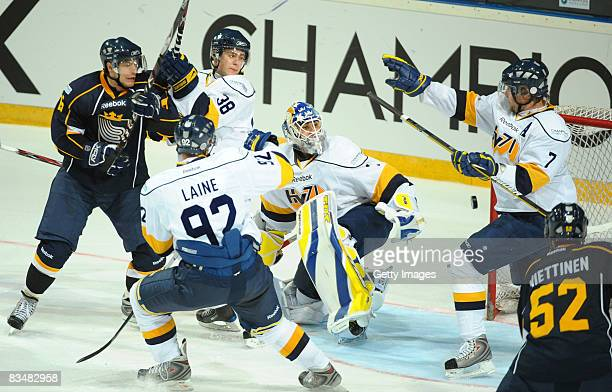 Teemu Laine defends with his team mates during the IIHF Champions Hockey League match between Espoo Blues and HV71 Jonkoping on October 29, 2008 in...