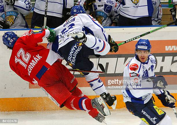 Teemu Laine of Finland looks at his teammate Ari Vallin and Czech Leos Cermak competing during Channel One Cup an event of the Euro Hockey Tour match...
