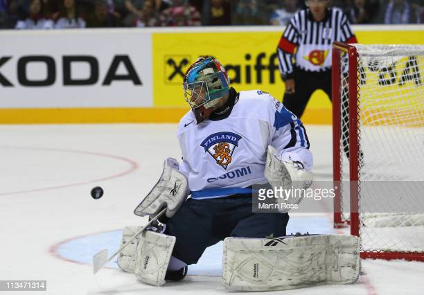 Teemu Lassila, goaltender of Finland saves the puck during the IIHF World Championship group D match between Latvia and Finland at Orange Arena on...
