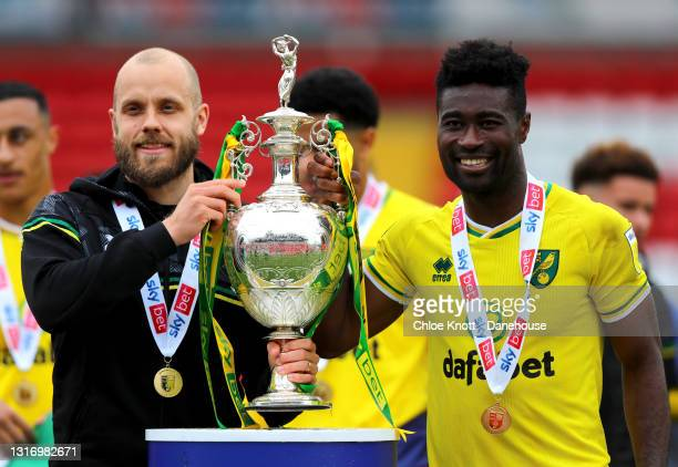 Teemu Pukki and Alexander Tettey of Norwich City pose with the Sky Bet Championship trophy during the Sky Bet Championship match between Barnsley and...