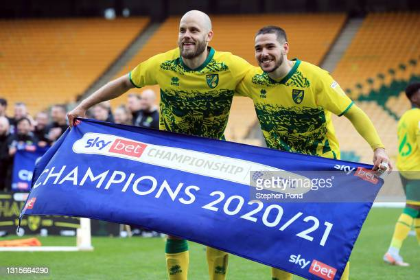 Teemu Pukki and Emiliano Buendia of Norwich City celebrate winning the Sky Bet Championship after the Sky Bet Championship match between Norwich City...