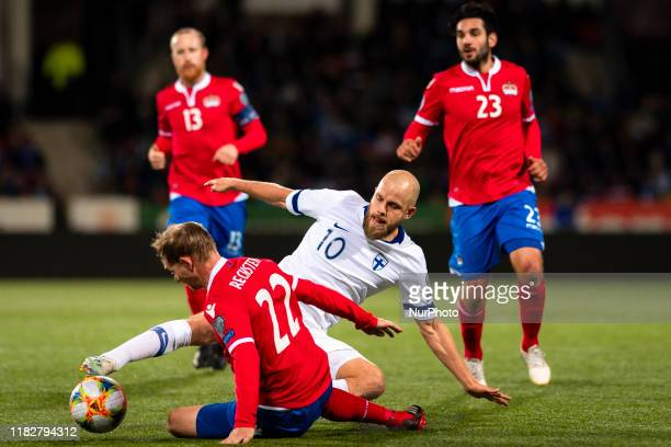Teemu Pukki and Martin Rechsteiner compete for the ball during the UEFA Euro 2020 Qualifier between Finland and Liechtenstein on November 15, 2019 in...