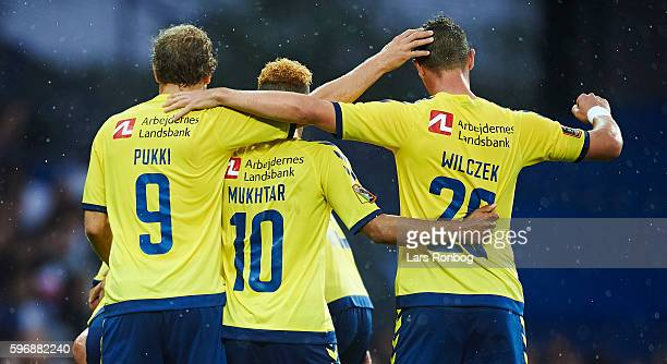Teemu Pukki Hany Mukhtar and Kamil Wilczek of Brondby IF celebrate after scoring their first goal during the Danish Alka Superliga match between...